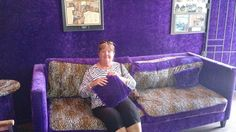 Sharron sitting on the purple couch at counting cars Counts Kustoms Las Vegas NV