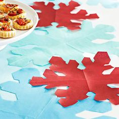 Snowflake Table Decor: Looking for chic (but cheap!) table decor? Use our downloadable snowflake pattern -- just place it at the folded napkin corner, trace it, and cut out the design.