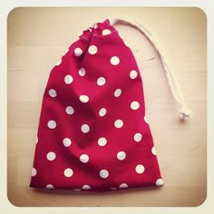 An easy Tutorial from Little White Cottage showing how to make a drawstring bag.
