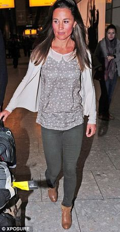 Pippa dressed down for the long flight, wearing Peter Pan collared top and cashmere cardigan with her customary skinny jeans