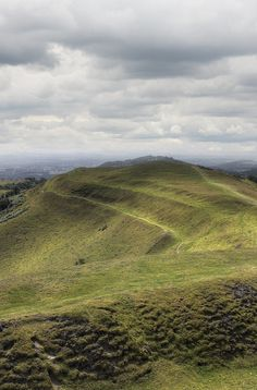 The British Camp, Malvern by GethinThomas on Flickr.  Via Flickr: The British Camp is an Iron Age hill fort located at the top of Herefordshire Beacon in the Malvern Hills. The hillfort is protected as a Scheduled Ancient Monument and is owned and maintained by Malvern Hills Conservators. The fort is thought to have been first constructed in the 2nd century BC. A Norman castle was built on the site. The extensive earthworks remain clearly visible today and determine the shape of the