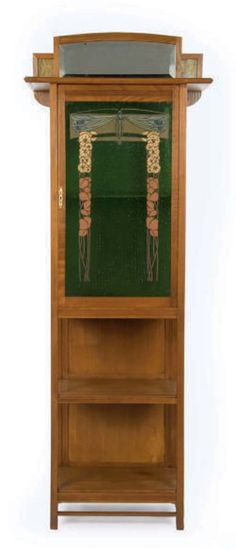 AN AUSTRIAN SECESSIONIST MOVEMENT WALNUT AND STAINED GLASS TALL CABINET WITH MIRROR, EARLY 20TH CENTURY.