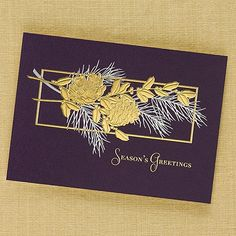 Pine Cone Holiday Card Captivate everyone on your card list with this classic holiday card. Timeless Christmas decorations of evergreen, pine cones and holly are decked in shining gold and silver embossed foils on a dramatic eggplant purple paper.