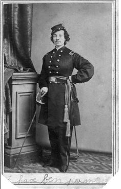Pauline Cushman wearing an officer's uniform. The photograph was taken between January and June 1864. She was an American actress and a spy for the Union Army during the American Civil War.