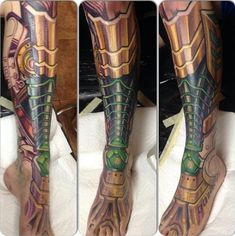 This robot leg tattoo was done by Mike Cole.