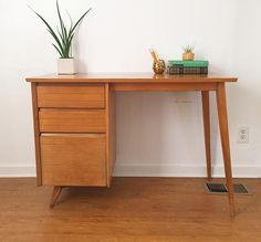 A stylish Mid-century solid maple desk made in New York by Baumritter.