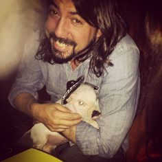 Dave Grohl with a piglet in a sombrero.