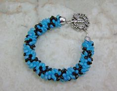 Great beaded kumihimo bracelet I made recently for another challenge. Love the colors in this one too. Black and frosted aqua magatama beads used