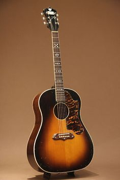 Gibson Recording King Ray Whitley Jumbo (c1939) : Flagship model of Recording King. Adirondack Spruce top, Brazilian Rosewood back & sides.