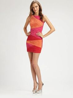 Allover ruching lends flattering texture to this brightly-hued colorblock design by bcbgmaxazria http://myxxology.styleowner.com/product/644247-Ruched-Colorblock-Dress