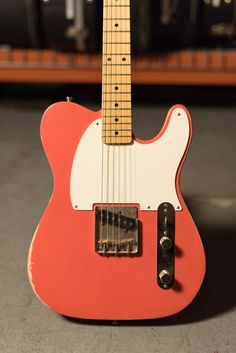 "Here's a smokin' hot ""Pastel Red"" Esquire Partscaster owned by Pat Sansone of Wilco. Gibson Guitars, Fender Guitars, Fender Stratocaster, Fender Esquire, Guitar Sketch, Guitar Photography, Beautiful Guitars, Guitar Pedals, Guitar Design"