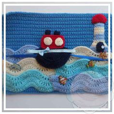 The Page:SKILL LEVEL:Easy: Basic stitches, no shapingSIZE:Page Size – 27 cm (length) x 33 cm (width)MATERIALS:Yarns:-50 grams of double knitting/medium worsted yarn in BLUE, LIGHT BLUE AND BE…
