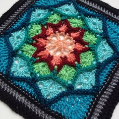 Crochet Motif Ravelry: Sun Catcher Afghan Square pattern by Julie Yeager - Like light shining through a stained-glass window, this afghan square will brighten your day. It is easy to stitch with only a few post stitches; most is single and double crochet. Crochet Squares Afghan, Crochet Blocks, Granny Square Crochet Pattern, Afghan Crochet Patterns, Crochet Motif, Knitting Patterns, Knit Crochet, Granny Squares, Double Crochet