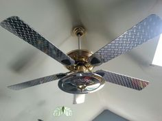 Take an ugly fan add chrome vinyl. Makes garage themed bedroom complete