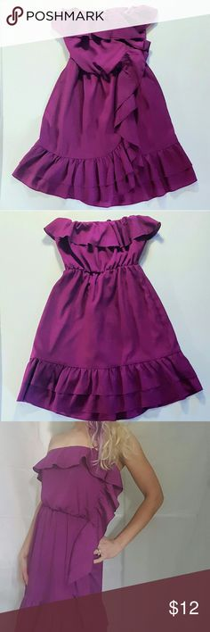 """Flirty Ruffled Strapless Dress So adorable! Gently used condition. Pull-on, 100% polyester, lined (also polyester). Size 7 juniors translates to about a medium, but it can also fit a small (see last 2 pics). Stretches comfortably. More on the raspberry side of purple.   Approx 12"""" across top of bodice, 28"""" overall length. Mixxed26 Dresses Strapless"""
