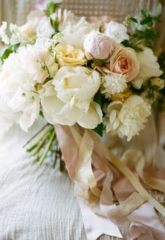 White orchids, white peonies, pink and ivory roses, white iris, white freesia // Gabe Aceves Photography