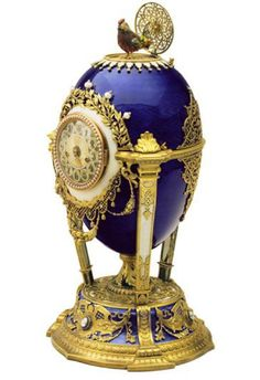 The Cuckoo Clock Egg (or The Cockerel Clock Egg), gold, diamonds, natural feathers, pearls, ruby, 1900, Presented by Nicholas II to Dowager Empress Maria Fyodorovna. Svyaz' Vremyon Fund - Viktor Vekselberg Collection - Moscow