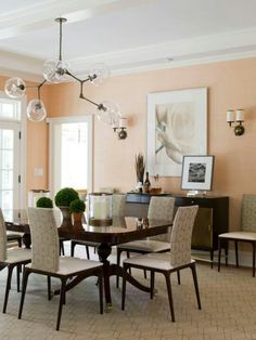 I love the idea of doing a peach paint in our dining room since it's adjacent to the kitchen which will have granite counter tops, hopefully with specs of peach in them. :D and a light white table.