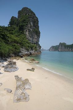 Remembering lazing around on this beach :) Postcard perfect beach cove, Halong Bay