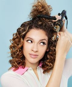How To Style Curly Hair | This DIY tutorial teaches you three easy, beautiful hairstyles for curly hair. #refinery29 http://www.refinery29.com/how-to-style-curly-hair
