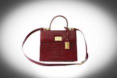 Patent red handbag