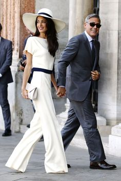 Amal Clooney in Stella McCartney with new husband George on September 29, 2014 in Venice, Italy