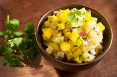 Tropical Fruit Salsa - This salsa recipe is sweet, zesty and low-calorie! Scoop some up with baked whole wheat tortilla chips or use it as a topping for chicken or fish. My personal favorite is to add to tacos! #cleaneating #lowcalorie #superfoods