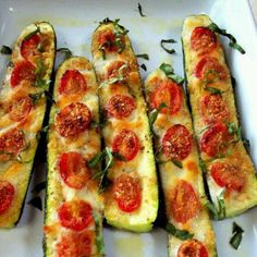 Cheeze zucchini - vegetarian dinner  Preheat oven to 375. Cut zucchini in half and brush with olive oil. Top with garlic or garlic powder, sliced tomatoes, and salt and pepper to taste. Use mozzarella, Parmesan, or mixed blend cheese. Baked at 375 for 20-30 min until soft.