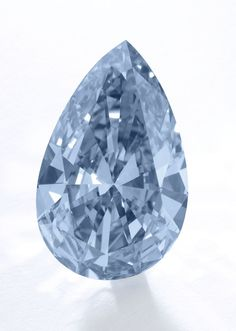 'THE APOLLO BLUE'. SUPERB AND EXTREMELY RARE FANCY VIVID BLUE DIAMOND. Now 'THE MEMORY OF AUTUMN LEAVES'. The pear-shaped fancy vivid blue diamond of truly and outstanding colour and purity weighing 14.54 carats, mounted as an earring with a pear-shaped and a brilliant-cut diamond, post fitting. Estimate 38,329,731 - 50,429,359 USD // LOT SOLD 42,087,302 USD. GIA / the diamond is Fancy Vivid Blue, Natural Colour, Internally Flawless, type IIb [S. 16 MAY 2017 - GENEVA] #ApolloBlue