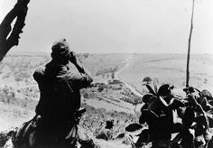German troops keeping watch over a road from a hilltop forward observation post. Sicily 1943