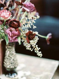 Burgundy and Berry Centerpiece in a Vintage Vase | Taralynn Lawton Photography | http://heyweddinglady.com/moody-dark-fairy-tale-wedding-shoot-mountains/