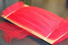 easy way to cut lengths of tulle or ribbon or yarn, etc.