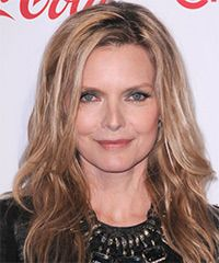 Michelle Pfeiffer -Layers are cut all around the sides and back of this casual hairdo to enhance soft movement and lighten the length. Highlights are added all over for contrast and will need regular touch-ups to maintain style. Product is needed for hold and shine.
