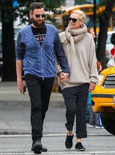 So in love: Tilda Swinton and her artist boyfriend Sandro Kopp walked  hand-in-hand while ...