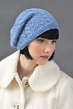 Free knitting pattern for lace and cable hat -- requires registration to download