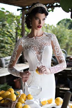 Such a beautiful wedding dress with illusion long sleeves! Berta, 2015