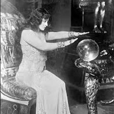 Fortune telling with crystal ball.