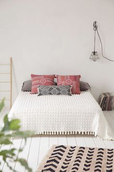 Tufted Dot Coverlet, $189 @ urban outfitters