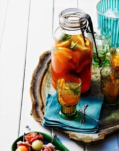 Old mason jar used as party beverage container... love the use of the old serving tray.