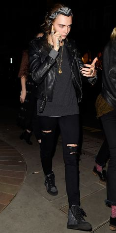 Cara Delevingne proved the staying power of the cool classic with a black leather jacket, tee, bandana, and sneakers. She prefers her black skinnies to be artfully ripped.