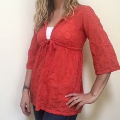 """J. Crew blouse J. Crew blouse size small. Perfect with shorts over a bathing suit. Tie front. 100% cotton. Measurements under arm to underarm 18"""". Length 27"""". In good used condition. Reddish orange color. Slightly sheer. J. Crew Tops Blouses"""