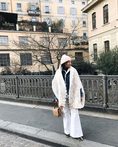 25 Instagram-Approved Ways To Do Winter Layering  #refinery29  http://www.refinery29.com/winter-layering-street-style-trend-photos#slide-8  Winter whites and lots of layers. When a poncho isn't enough, always (always!) add a Sherpa coat on top. (A matching beanie doesn't hurt, either)....