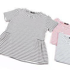 This striped shirt has a feminine peplum detail, the perfect way to dress up your everyday outfit!