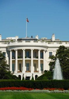 The White House, the iconic residence of the sitting President of the United States; an unrecognizable Secret Service Agent watches from the roof.  For more information, visit the Washington, D.C. Destination Guide.