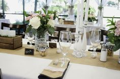 our rustic wedding decor with mason jars: Black and white gingham, burlap, lace, lovebirds, pink flowers, white flowers.