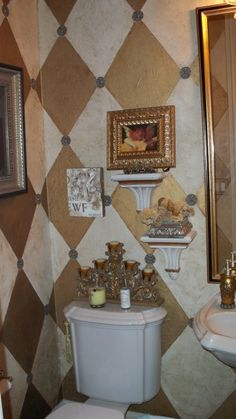 Tiny Powder Bath - accessory do over?, Harlequin Tissue paper on walls, gold ceiling. , Cream and Gold tissue paper on walls with silver antiqued medallions in the centers.   Before do over: Too many things on the wall      , Bathrooms Design