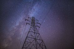 #electrical tower #electricity #energy #high voltage #night #power #power lines #power pole #sky #stars #upper lines #utility pole #royalty free images