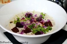 Chilled cauliflower soup with purple cauliflower, micro celery leaves, and pumpernickel croutons. The Tasting Room, Frederick, MD