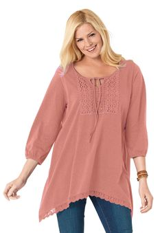 "Great style is in the details of our plus size trapeze tunic top. Add boho flair to your wardrobe with keyhole neckline and beautiful crochet trims. our trapeze fit tunics afford freedom of movement30"" tunic offers comfy coverage down to the upper thighskeyhole scoop neck with drawstringcrochet bib adorns the front3/4 elasticized sleevesscalloped crochet hemsoft, washable cotton/rayon jersey knitimported Women's plus size bib-front tunic top in sizes M(14W-16W), L(18W-20W), 1X(22W-24W)…"