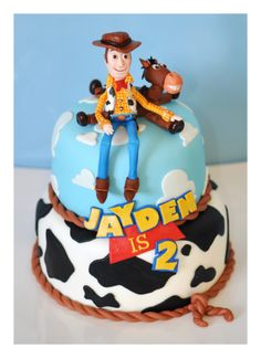 Toy story cake.  Handmade fondant/gumpaste Woody and Bullseye and hand...